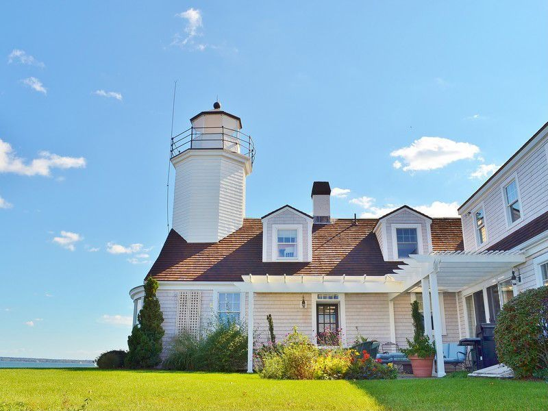Play lighthouse keeper with these homes for sale for Rhode island bath house