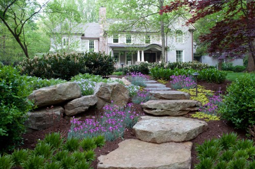 Up your home 39 s curb appeal with front yard landscaping for Curb appeal garden designs