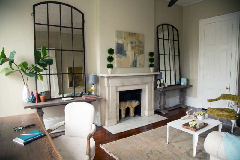 Create the feel of windows with large mirrors. Photo via Laurel & Wolf.