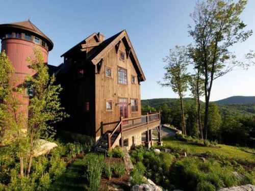 a timber frame house seems right at home in scenic vermont overlooking the green valley below the barn inspired home was built in 2010 combining rustic
