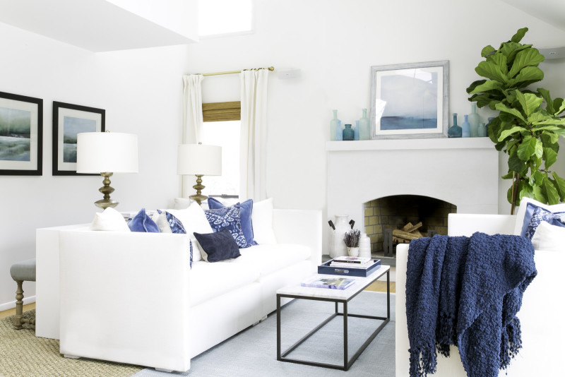 All white furniture creates a spring vibe in a living room. Photo via Laurel & Wolf.