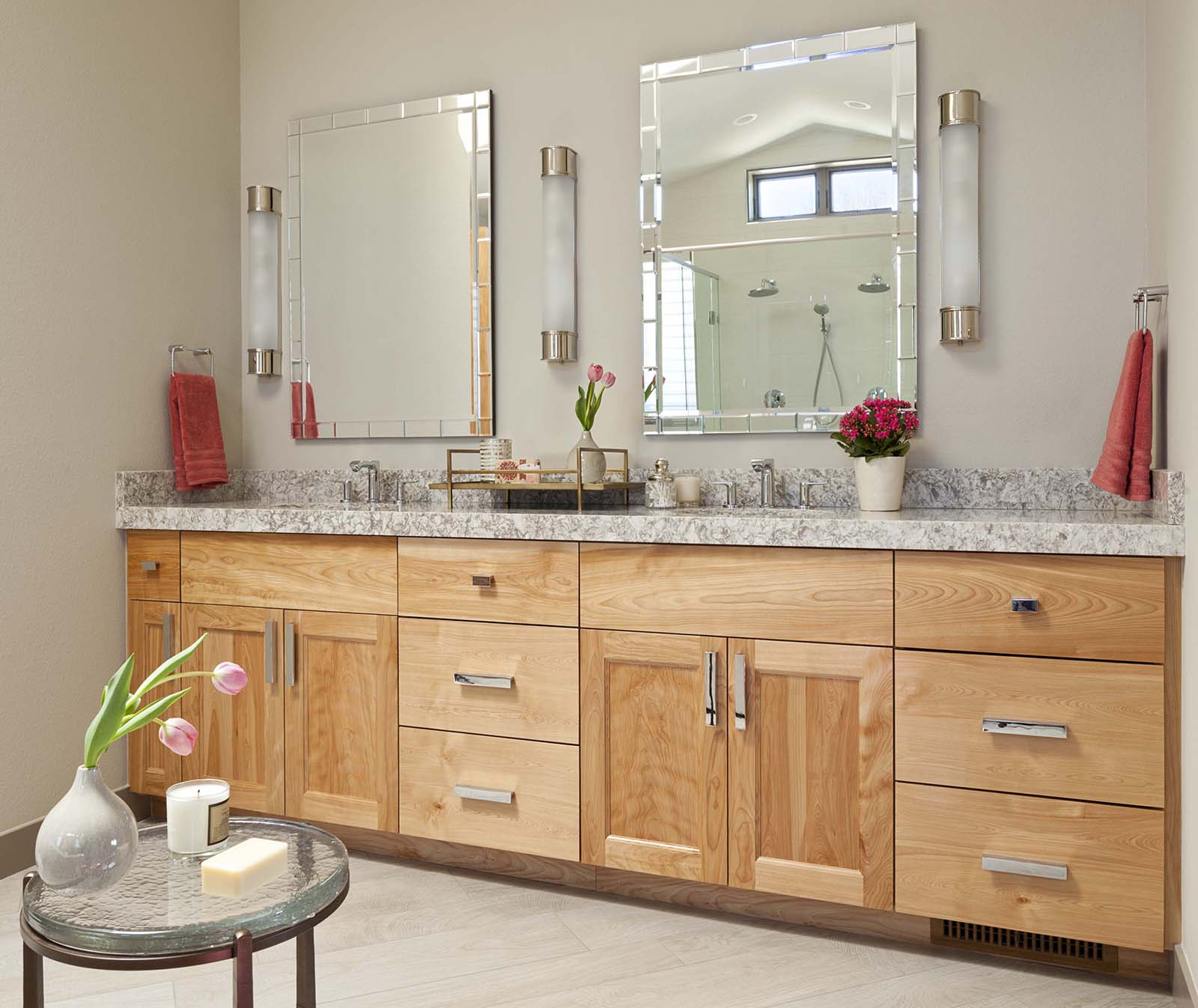 Epic Decorative mirrors add a hint of glamour to the vanity while sconces from Visual Comfort are hung at face height for optimal lighting when beautifying in