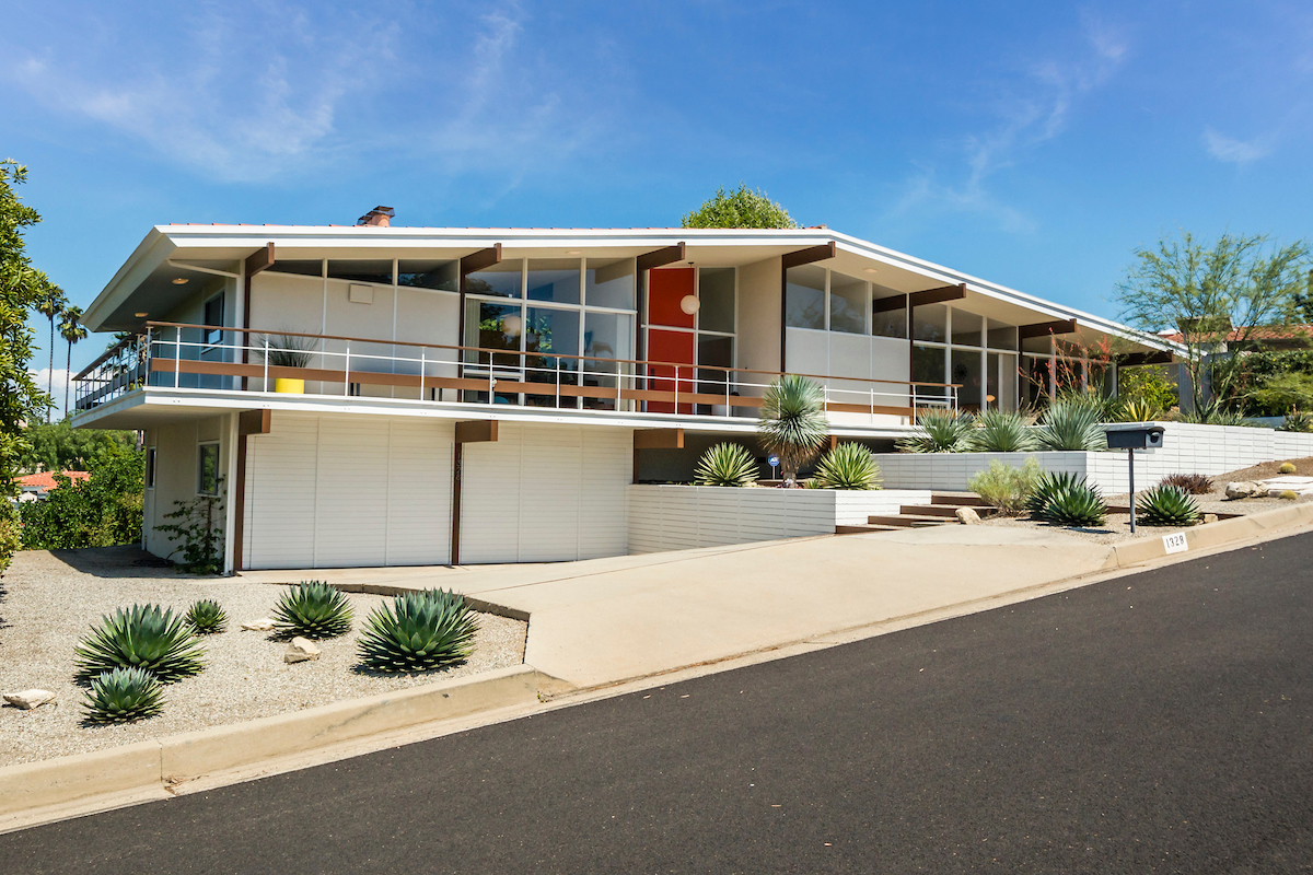 This mid century home originally designed for a wwii pilot for Century home builders