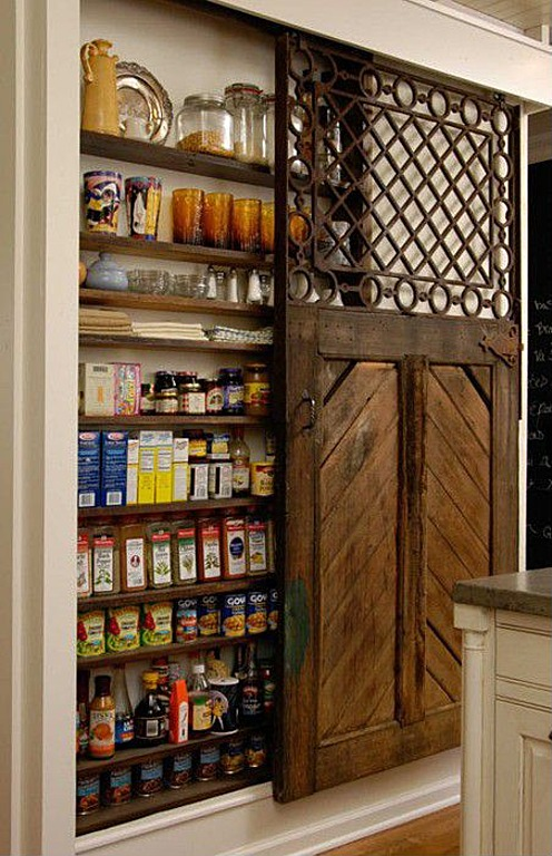 a pantry fits nicely behind this vintage sliding door