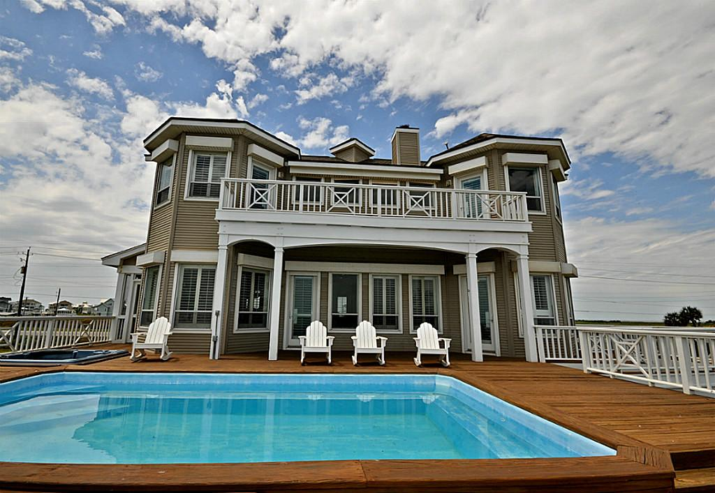 Country singer clay walker drops price on texas beach house for Beach house plans galveston