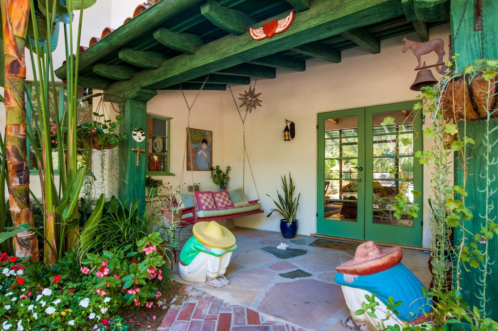 Actress annie potts designed this funky hacienda for Mexican porch designs