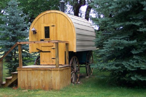 youve got a bed a little wood stove to cook on a table that pulls out and two benches dehn said in 2003 she and her husband replaced the original - Sheep Wagon