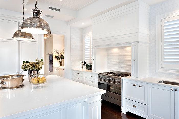 custom kitchen with white cabinets, walls and countertops