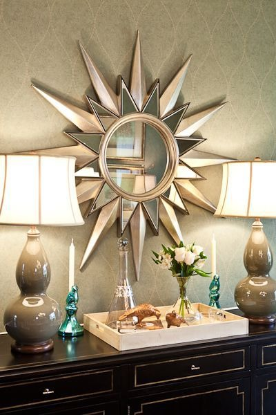 a large sunburst mirror makes a statement in this home done by eric ross interiors - Ross Home Decor