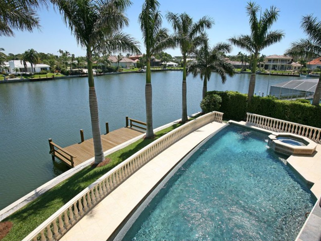 Former nba great larry bird selling naples home for 4 8 for Pool design naples fl