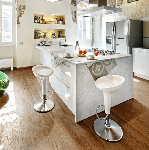 Use statement chairs for kitchen islands with unusual heights. Photo via Zillow Digs.