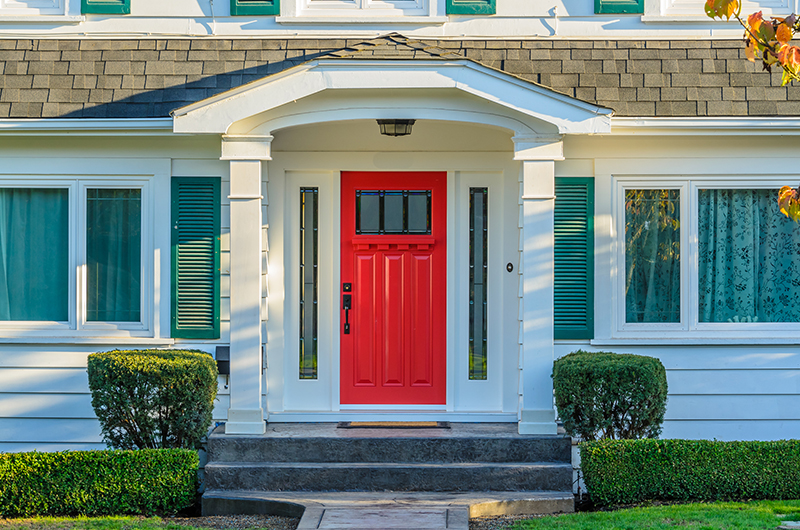red front door on traditional home