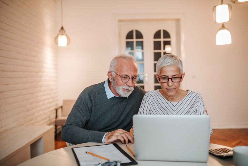 Senior couple reviewing their mortgage information on a laptop