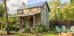 log cabin for sale in Fredericksburg, TX