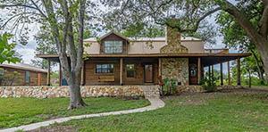 log cabin for sale in Cuero TX