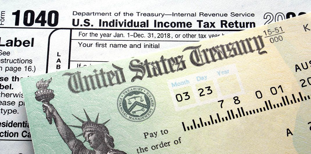using tax return to pay off debt
