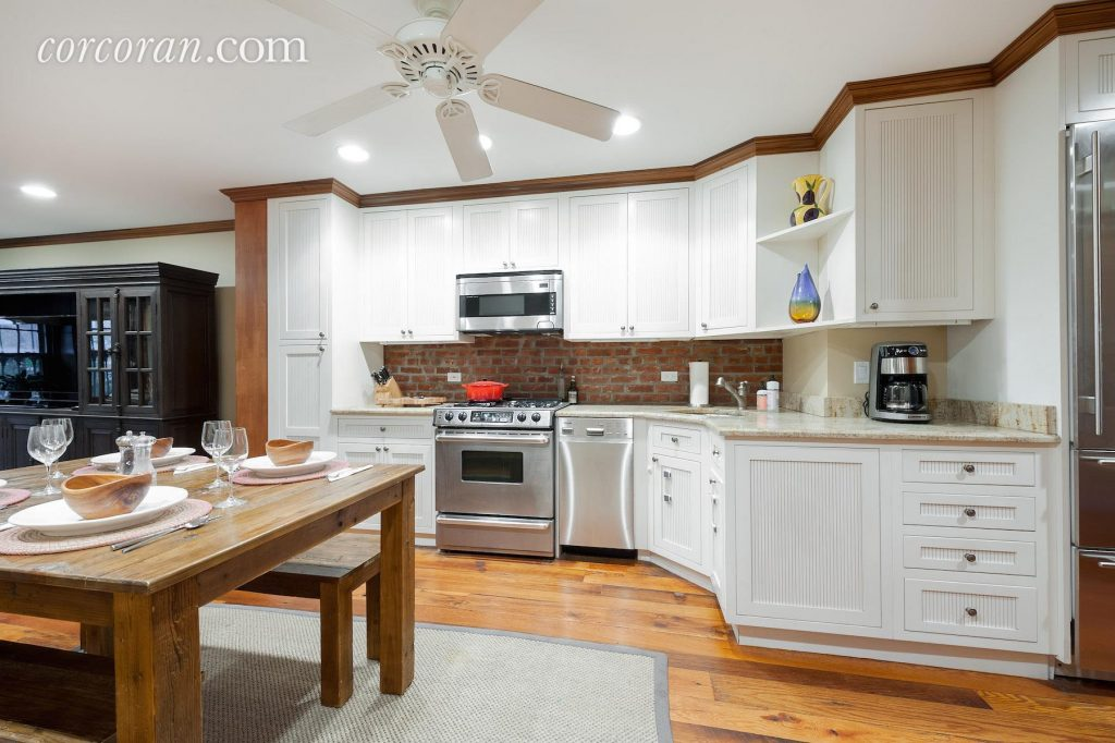 The eat-in kitchen at 493 13th Street #1.