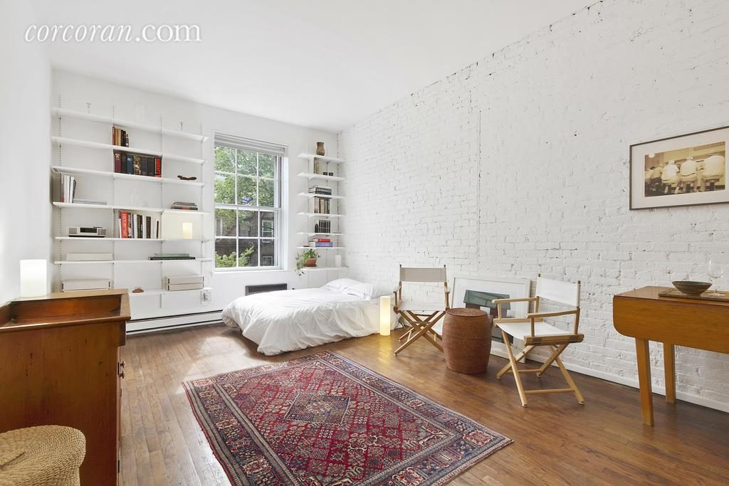 This Chelsea Apartment Has Its Interior Brick Wall Painted White.