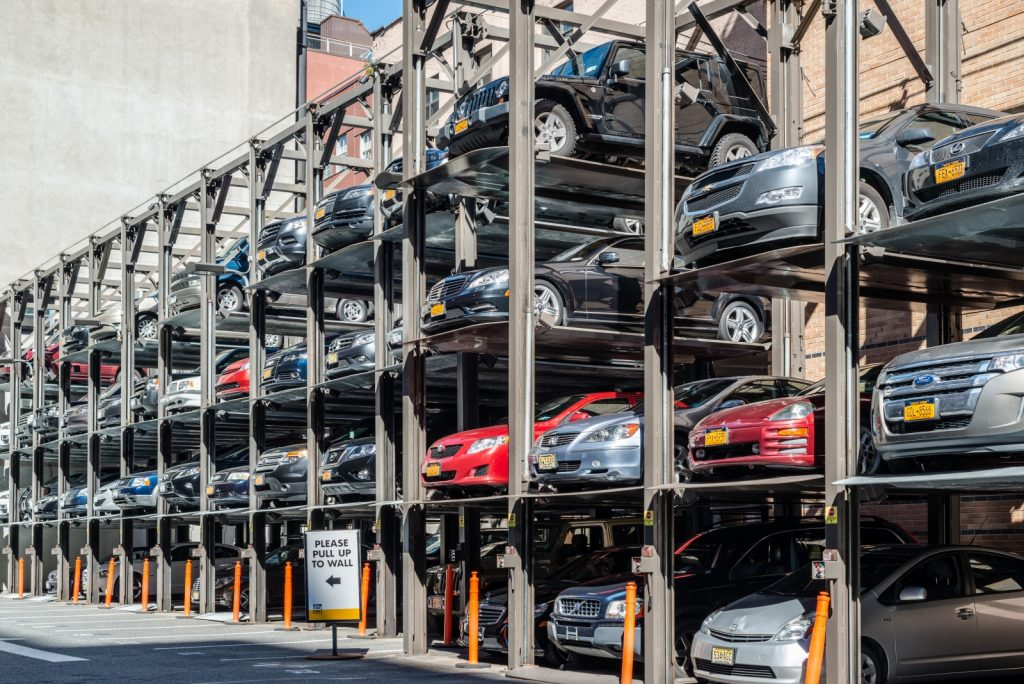 Nyc car insurance how do you keep costs down streeteasy image of cars stacked in new york city vertical parking lot solutioingenieria Gallery