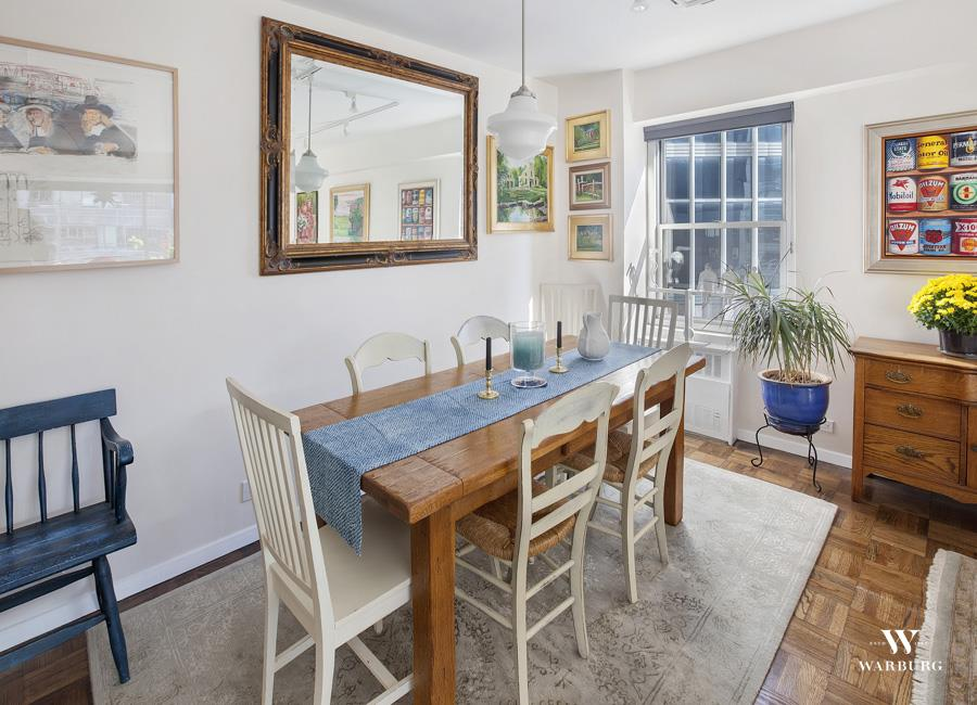 The kitchen and dining room at 118 East 60th Street #19G.