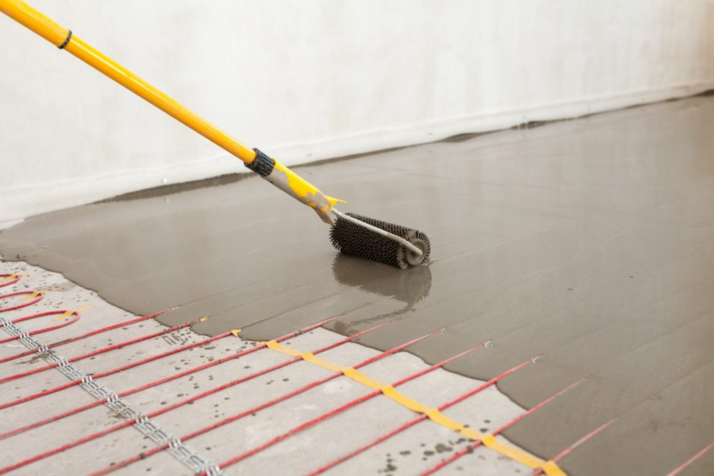 Pros and cons of heated floors streeteasy for Electric radiant heat efficiency