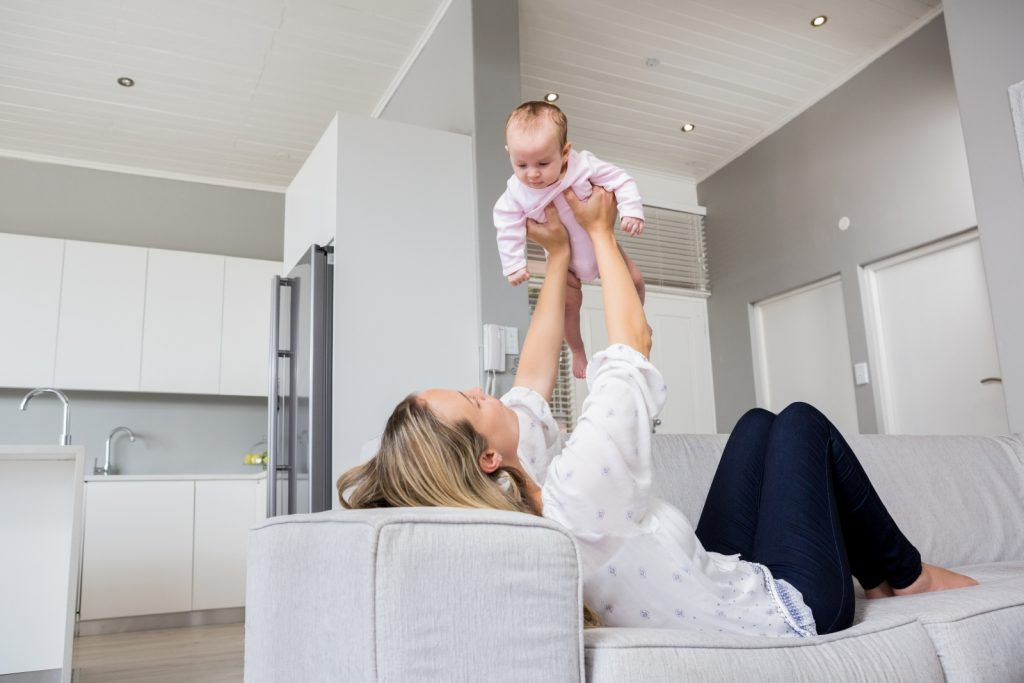 Image Of Mother And Baby Playing In An Apartment