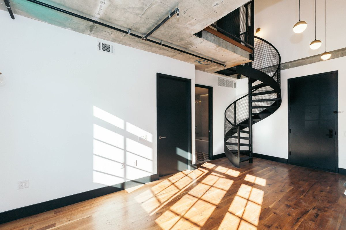 A Duplex Apartment With Metal Spiral Staircase