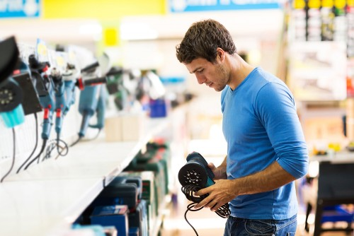 man in hardware store shopping