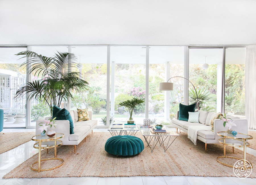 Light Filled White Living Room With Teal Tufted Ottoman