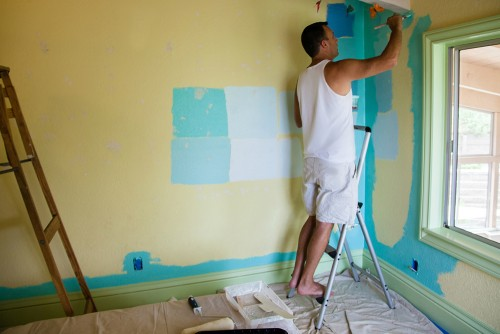 man making home improvements