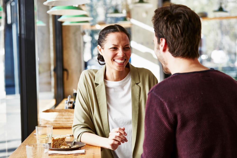 Man and woman chatting at a bar