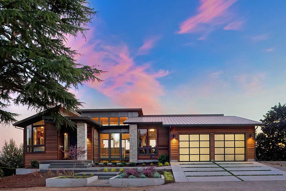 20 percent down payment modern home exterior at sunset