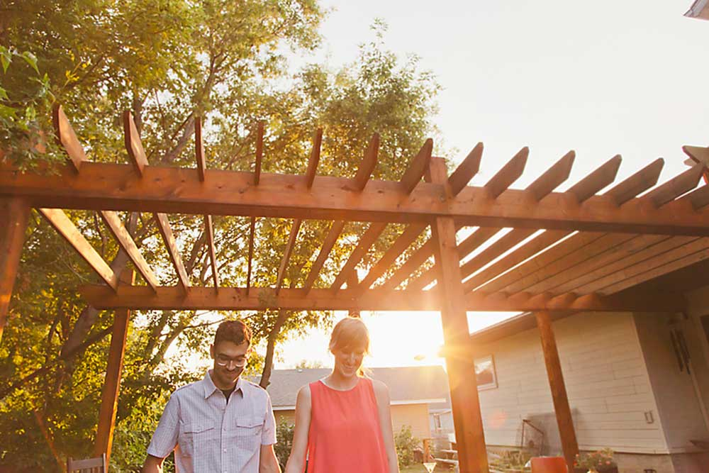 house hunting couple outside under pergola