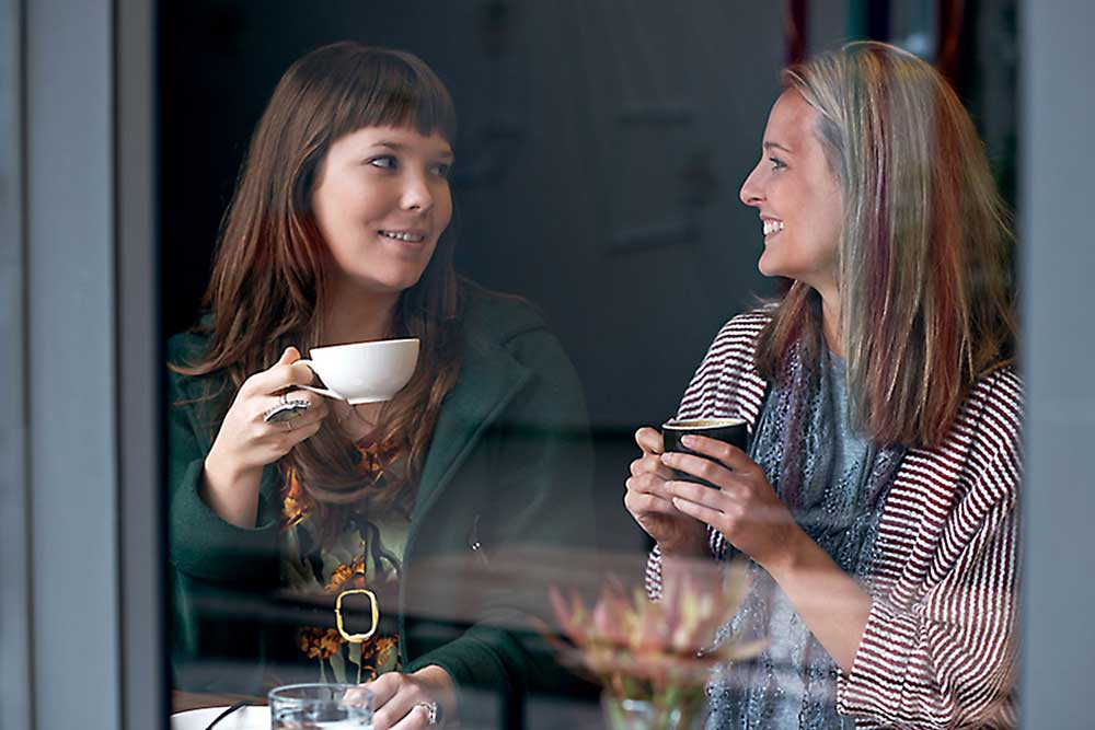 Women holding coffee cups
