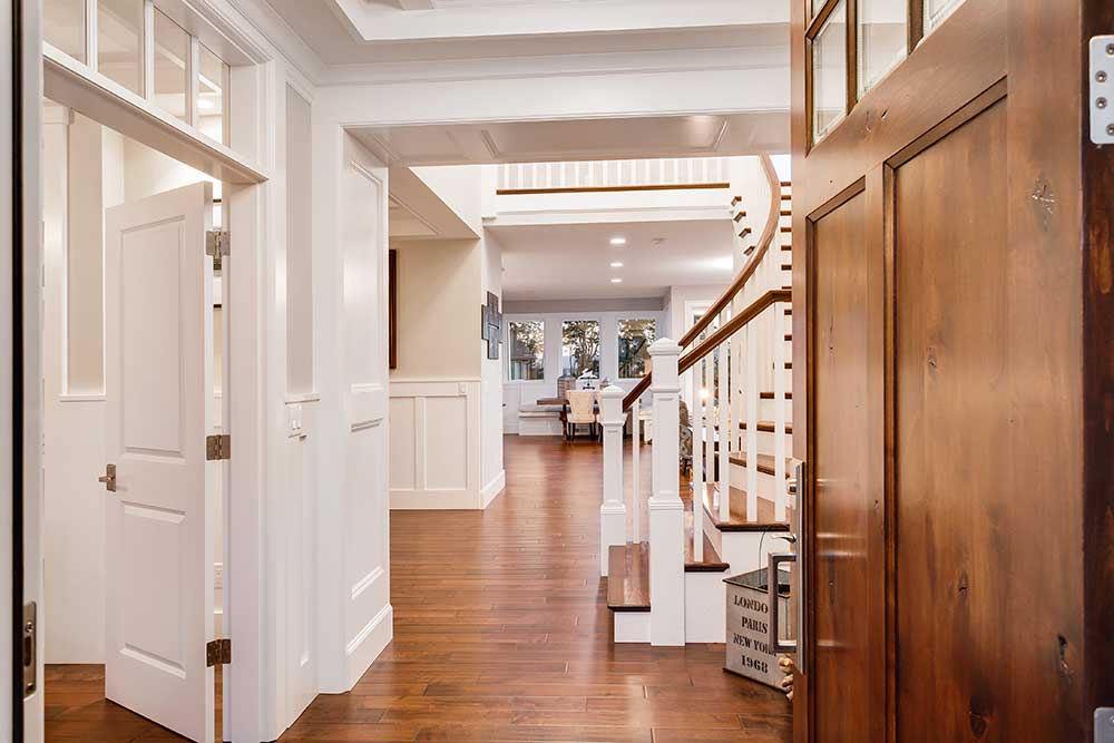 Hallway interior of home with wood floors