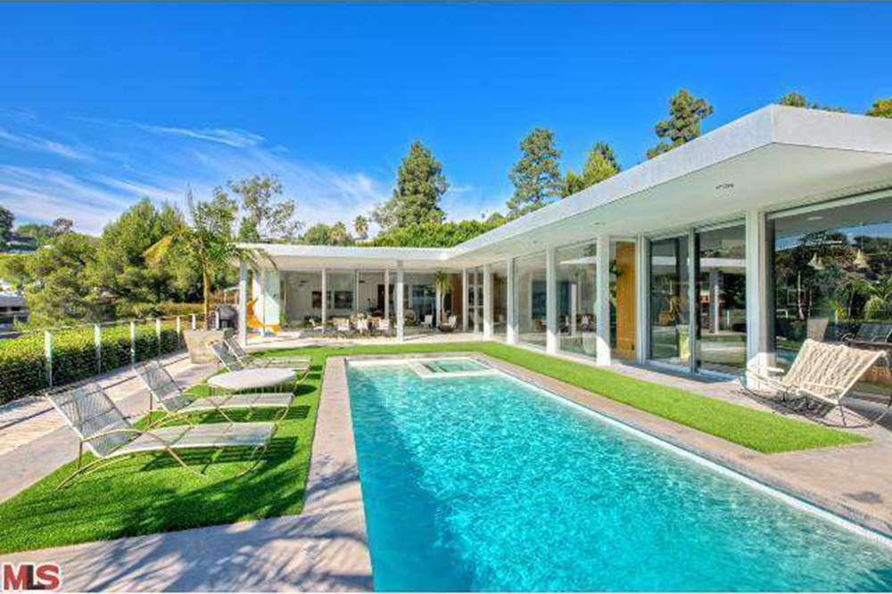 May2015-Trulia-X-Celeb-Homes-Perfect-for-a-Poolside-Soiree-Jimmy-Buffett-pool