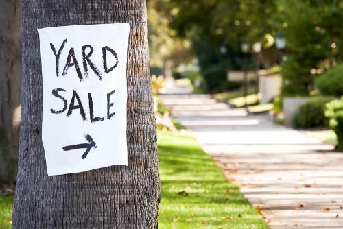 yard sale sign on tree
