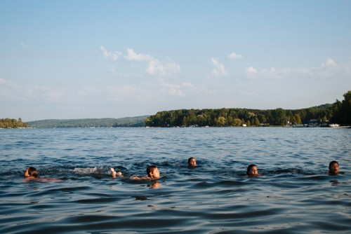 kids swimming in lake