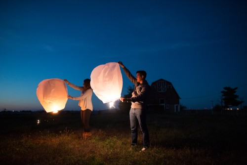 couple sending off lanterns