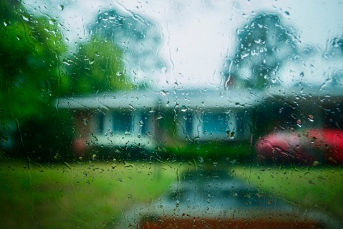 House through rainy window