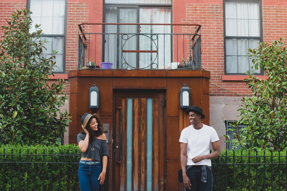 man and woman in front of house