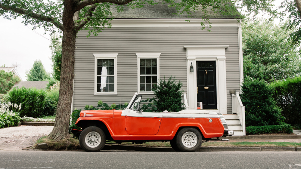 red car in front of house owners have anxiety over buying a house