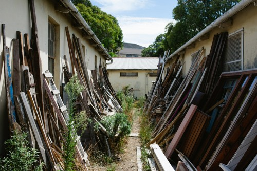 scrap wood in front yard of hoarding house