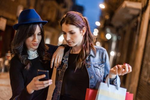 women shopping looking at phone