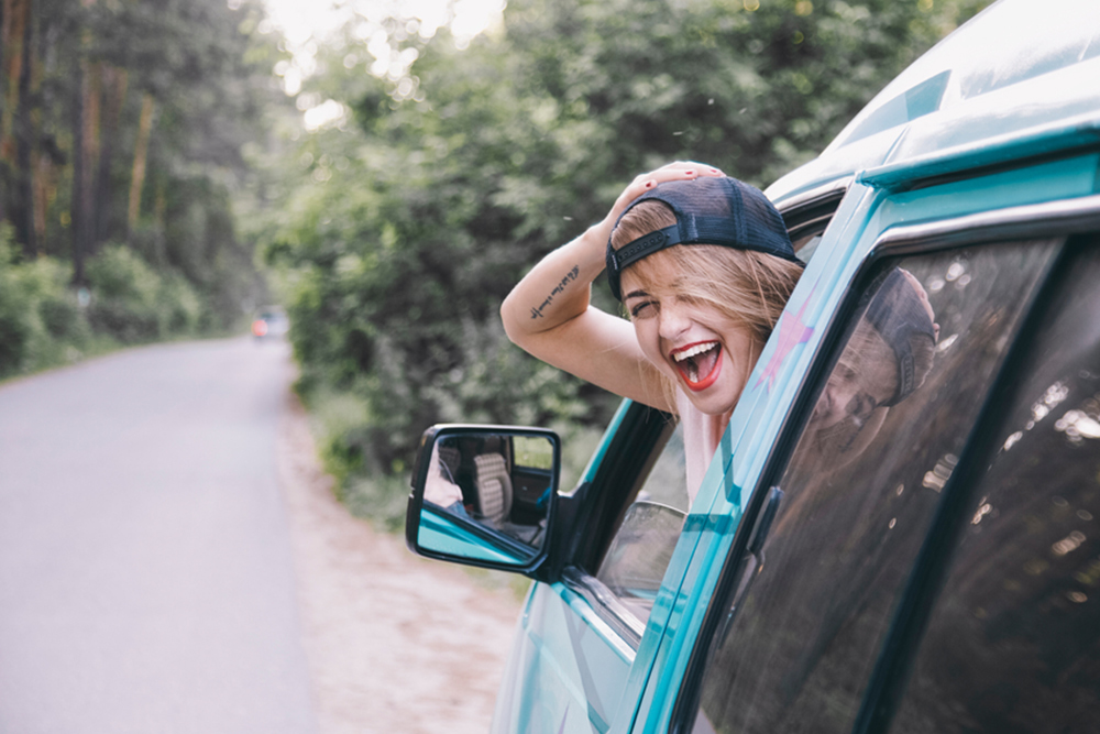 woman sticking her head out car window