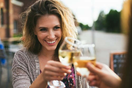 women raising wine glass