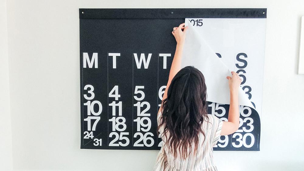 woman ripping off calendar