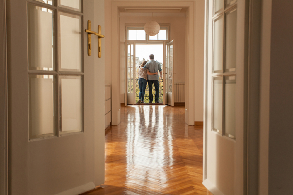 couple standing in door of new home