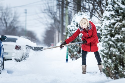 woman shoveling for sale house