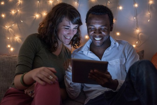 man and woman on tablet